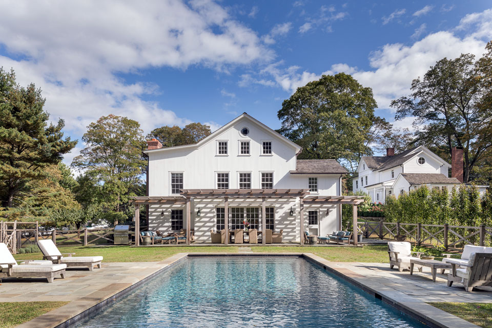 Swimming pool with home and pergola