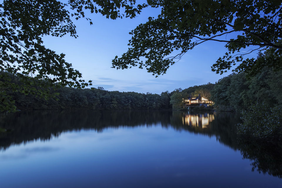 Evening lake view with contemporary house