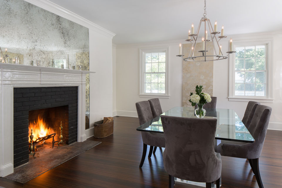 hardwood floor dining room with fireplace