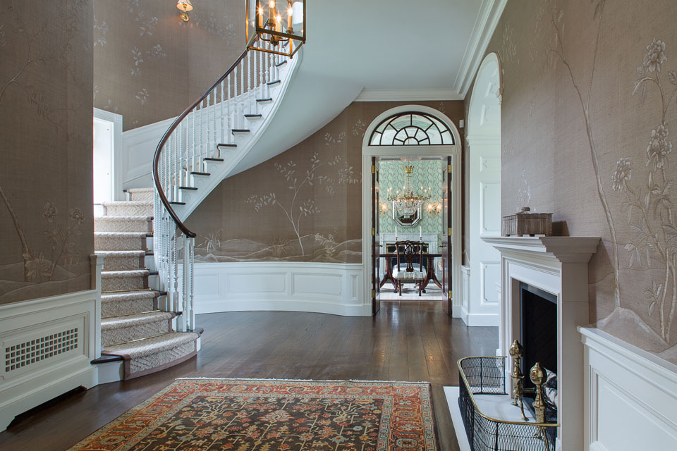 Entrance hall with fireplace and staircase