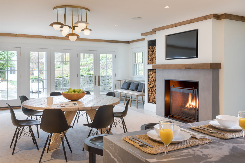Living space with table and chairs, and fireplace